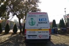 Reklama na busie vanie firmowym pomoc drogowa Prusinowscy w Bolesławcu