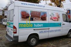 Reklama na busie vanie firmowym sklepu Hubert w Bolesławcu